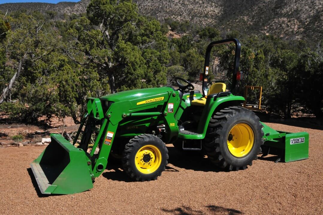 Smick Lumber John Deere Tractor w/ attachment
